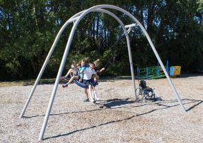 Children playing on playground swing