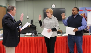 Board members being sworn in